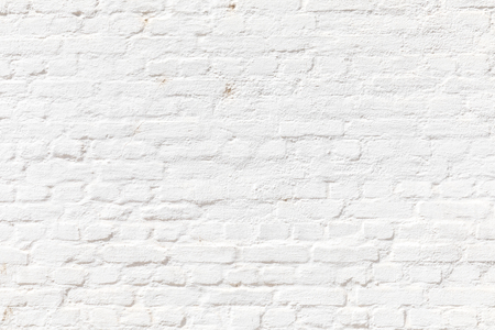pattern of white painted brick wall gives a harmonic neutral background Stock Photo