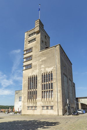 SANKT INGBERT, GERMANY - AUG 4, 2018: the concrete Becker tower was the former cental production place for a beer brewery, nowadays used as industry park.