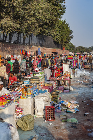 DELHI, INDIA - NOV 17, 2011: people in early morning go shopping at the central market Meena Bazaa.  Shah Jahan founded the bazaar in the 17th century inspired by the architecture of the Isfahan Bazaar.