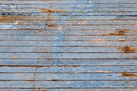 harmonic pattern of a n old rotten wooden plank in blue