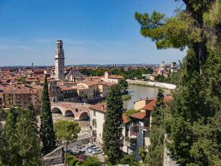 panorama of Verona with view of the old dome and the river with old roman bridge