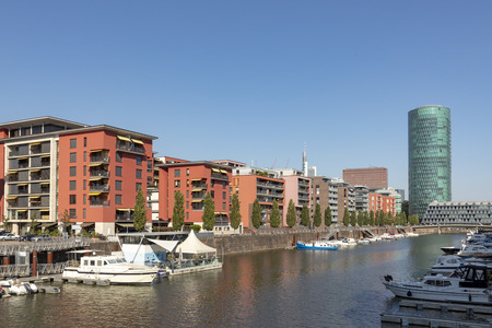 Westhafen Tower and private apartments in Frankfurt, Germany under blue sky