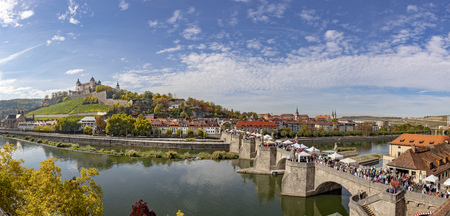 panoramic view of fortress Marienberg and old historic bridge crossing river Main in Wuerzburg, Germany