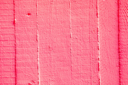 harmonic red wall background with structure of plaster