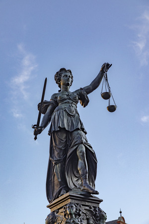 lady justice with the scale symbolizes the law under blue sky Stock fotó
