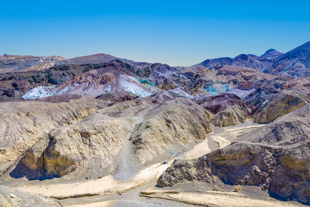 scenic road Artists Drive in Death valley with colorful stones, hills  with minerals, blinking colorful in the sun