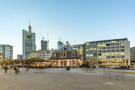 FRANKFURT, GERMANY - NOV 16, 2018: scenic skyline of Frankfurt am Main with skyscraper in the evening seen from Hauptwache with people on shopping street Zeil.