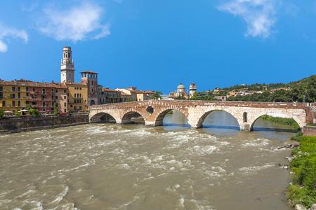 the old roman bridge in Verona  spans the river Etsch Stock Photo - 117451740