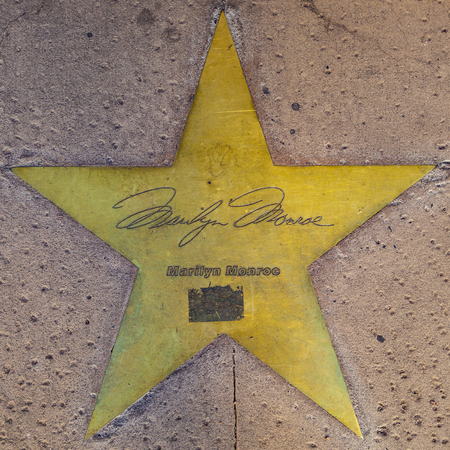 PHOENIX, USA - June 14, 2012: The name of stars in copper reflect the past glory of the Hotel San Carlos in Phoenix, USA. The stars in the sidewalk were put in in 1993 to commemorate the visits of luminaries of their day. Redakční