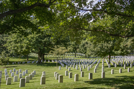 Arlington, USA - AUG 10, 2017: Gravestones on Arlington National Cemetery in Washington DC, USA. Headstones mark soldier graves who died in every conflict from Revolution to Sept 11. Editorial