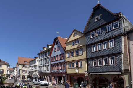 WERTHEIM, GERMANY - APR 6, 2018: people visit the pedestrian zone of the scenic medieval village of Wertheim i Bavaria, Germany. Stok Fotoğraf - 116936913