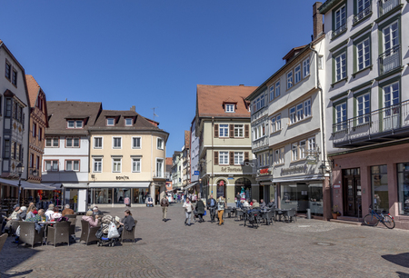 WERTHEIM, GERMANY - APR 6, 2018: people visit the pedestrian zone of the scenic medieval village of Wertheim i Bavaria, Germany.