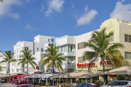 MIAMI, USA - AUG 5, 2013:   People walk along  Ocean drive with Art Deco   Hotels and Bars  in South Beach, Miami, USA. It is the most scenic Art deco district in the US.