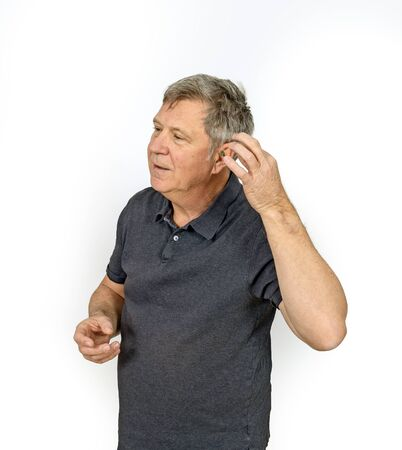 man with hearing aid in left ear