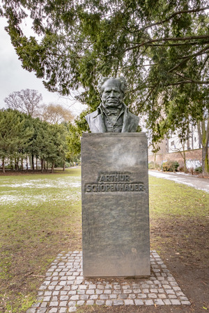 FRANKFURT, GERMANY - JAN 31, 2019: statue of philosopher Arthur Schopenhauer from artist Friedrich Schierholz from 1895 in Frankfurt.