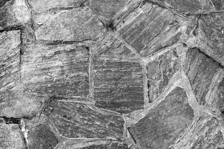 pattern of old irregular stones at a porch