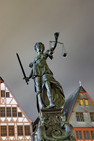 lady justice at the roemer square in Frankfurt am Main by night