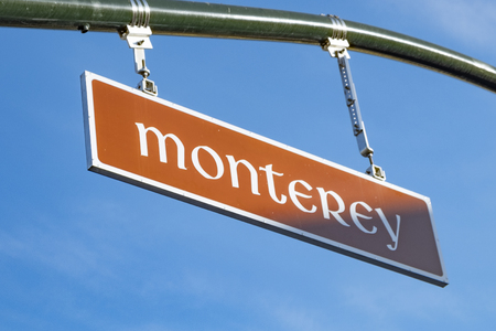 street sign Monterey under clear blue sky Stock Photo