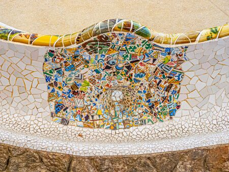 """Barcelona, Spain - FEB 28, 2015: Ceramic art in Park Guell in Barcelona, Spain. It was built in 1900-14 and is part of the UNESCO World Heritage Site """"Works of Antoni Gaudi"""". Editorial"""