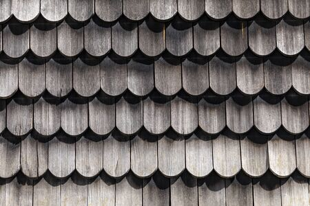 wooden weathered tiles at a house wall of a historic german house, Germany