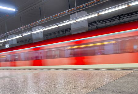 metro train with speed enters the train station in Frankfurt, Germany Banco de Imagens