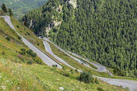 scenic curvy mountain pass road to the Timmelsjoch at the border of Italy and Austria in the Alps Stock Photo