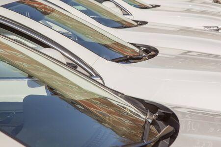 detail of white cars parking in a row Zdjęcie Seryjne