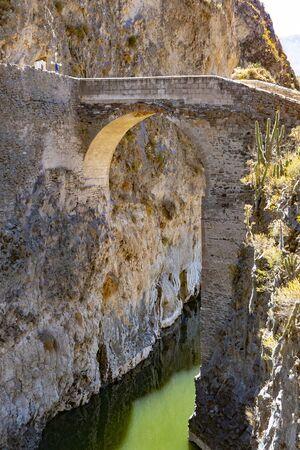stone bridge over Colca Canyon in Peru