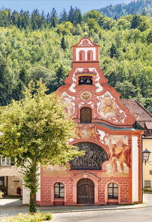 Fussen, Germany - August 4, 2019: The painted rococo facade of Holy Spirit Hospital Church, Fussen, Bavaria, Germany, Europe Editorial