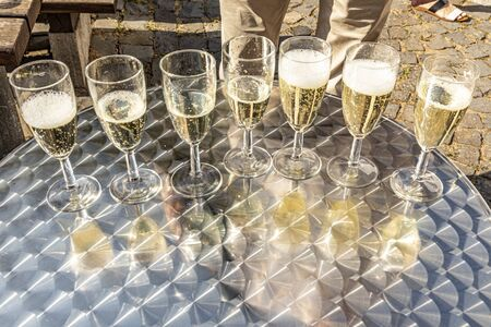 detail of glasses with sparkling wine with reflection at the table Banco de Imagens - 129323968