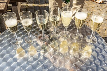 detail of glasses with sparkling wine with reflection at the table Banco de Imagens - 129323971
