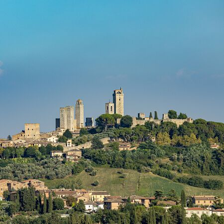 view to San Gimignano, old medieval typical Tuscan town with residential towers found therein in Italy