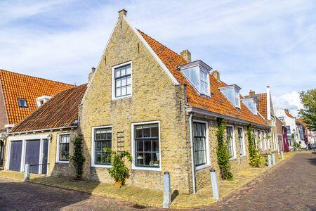 old traditional brick house in Harlingen under blue sky