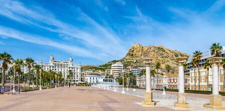 Houses on the promenade of Alicante in the Baroque style among palm trees, Pinnacles and spiers