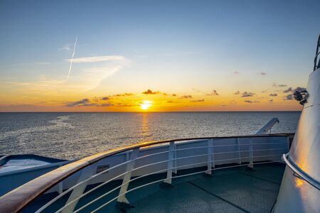 sunrise at the cruise ship with view to colorful horizon
