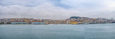The view on Lisbon city, Portugal with river Tejo and the old town.