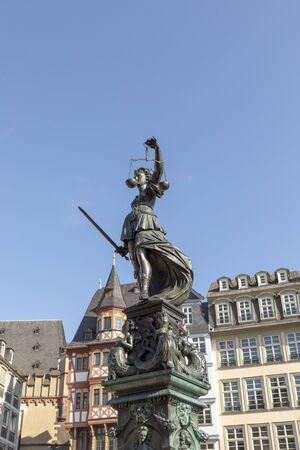fountain with lady justice in Frankfurt at the roemer 免版税图像