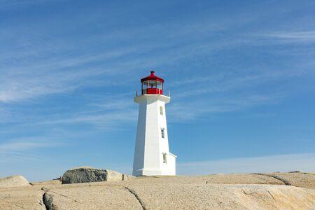Lighthouse on a rock at peggys cove, Nova Scotia Stock Photo