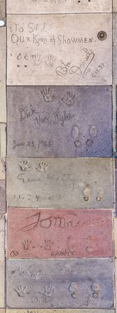 Los Angeles, USA - June 26, 2012: handprints of stars in Hollywood in the concrete of Chinese Theatre's forecourt  in Los Angeles. Editoriali