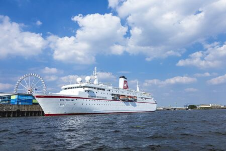 HAMBURG, GERMANY - JULY 17, 2014: Cruise ship MS DEUTSCHLAND, operated by Hapag-Lloyd Expedition Cruises, leaving Hamburg on the Elbe river.