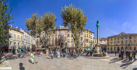 AIX EN PROVENCE, FRANCE - OCT 19, 2016: people visit the central market place with the famous hotel de ville in Aix en Provence, France.