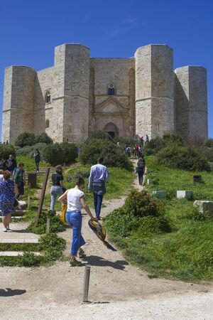 Castel del Monte, Italy - April 24, 2019: people visit famous castel del monte i Apulia, Italy.