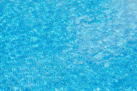 background of blue small tiles at a swimming pool as harmonic background with soft waves