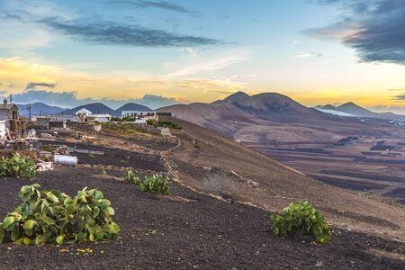 sunrise in Lanzarote seen from Volcano near Yaiza with dramatic sky, spain