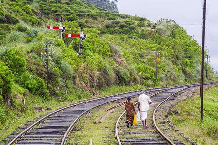 Nuwara Eliya, Sri Lanka - August 16, 2005: couple walks on the rails in Nuwara Eliya. The rils are good ways for walking in the Highlands. Editorial