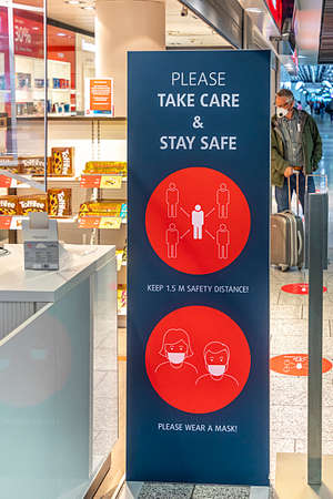 Frankfurt, Germany - June 8, 2020: sign please take care and stay safe at Frankfurt Airport.