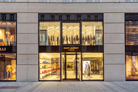 Vienna, Austria - April 25, 2015: foreign tourists from european and arabic countries visit vienna to go shopping in haute couture shops like Ives saint Laurent and others.