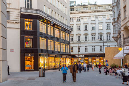 Vienna, Austria - April 25, 2015: foreign tourists from european and arabic countries visit vienna to go shopping in haute couture shops like Louis Vuitton and others.