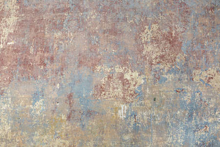 background of old wall with removed tapestry gives a harmonic look in paint of different ages
