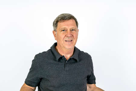Handsome middle age man studio portrait with white background